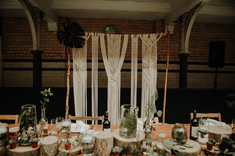 Handmade macramé wall for botanical styled reception with DIY decor