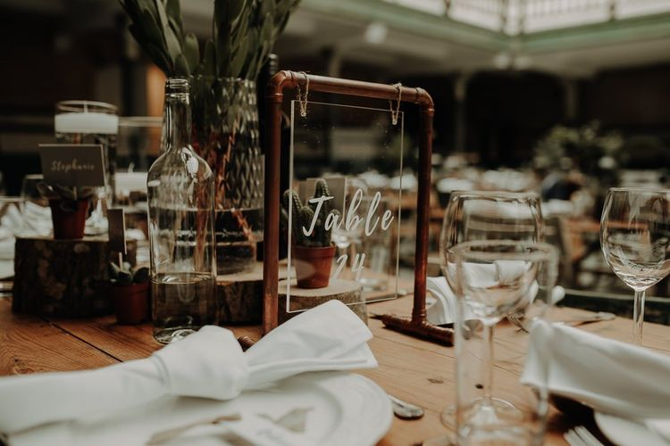 Rustic and botanical style table settings for relaxed reception in Manchester