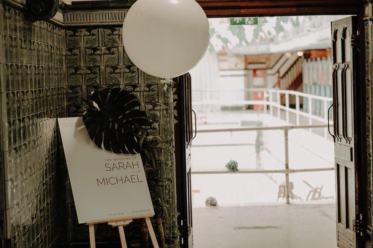 Wedding sign at Victoria Baths wedding reception with balloon decor
