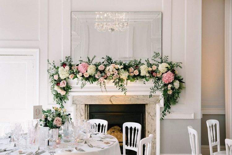 Floral Garland For Fireplace At Wedding // Waterside Wedding Venue London Winchester House Bride In Rime Arodaky & Groom In Reiss Images From Photography By Krishanthi