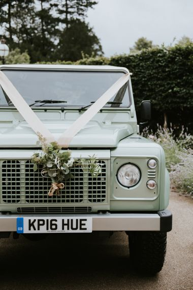 Mint green Land Rover transport