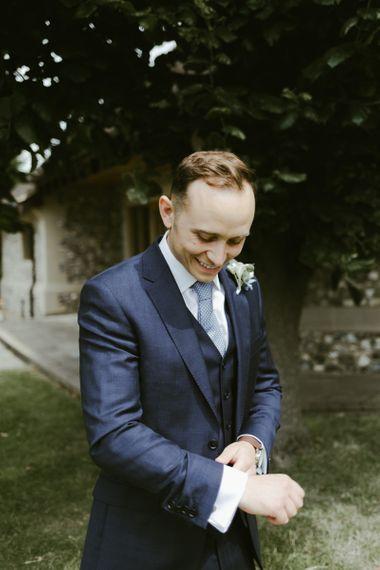 Groom in blue suit with blue tie