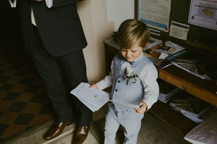 Page boy in pale blue waistcoat and trousers at Ramster Hall wedding