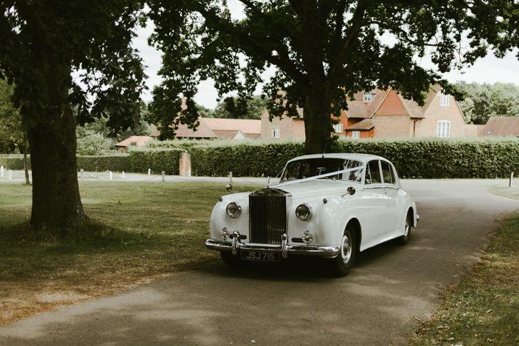 Vintage white Rolls Royce wedding car
