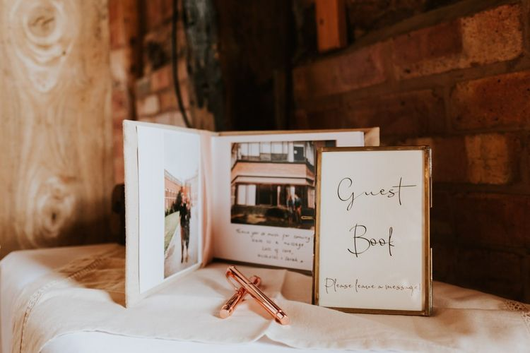 Summer barn celebration with personalised guest book and photographs