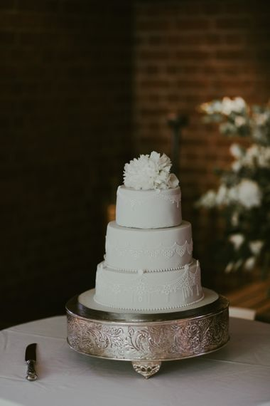 White wedding cake at Ramster Hall in Surrey
