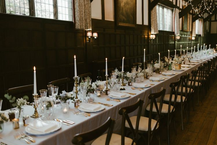 Wedding table decor with flowers and candles at Ramster Hall