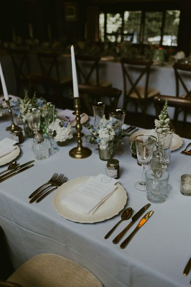Wedding table decor with blue and white wedding flowers
