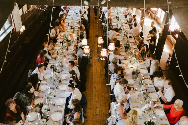 Guests enjoy wedding breakfast at Ramster Hall