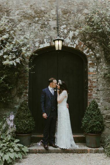 Bride in flower crown with groom