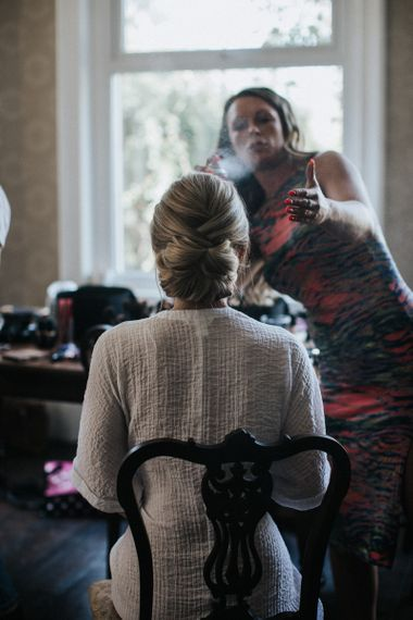 Wedding Morning Bridal Preparations with Bride Having Her Chic Up Do Done