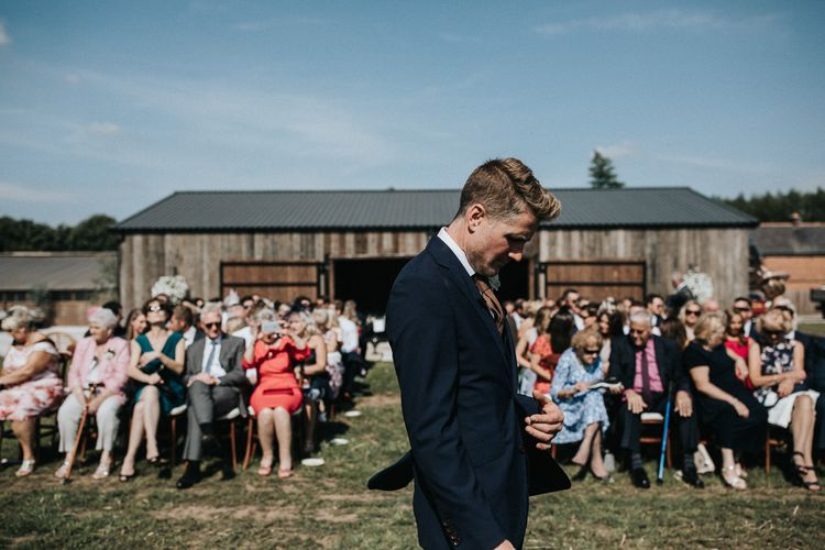 Groom Waiting at The Outdoor Wedding Ceremony Altar