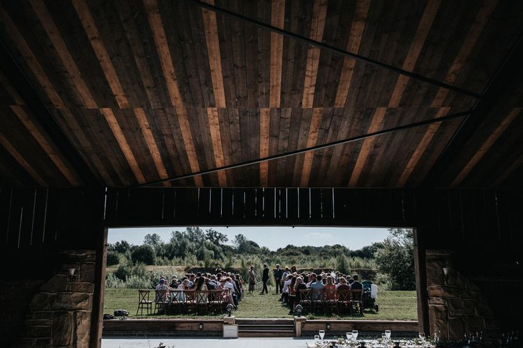 View of Outdoor Wedding Ceremony From the Barn Wedding Venue