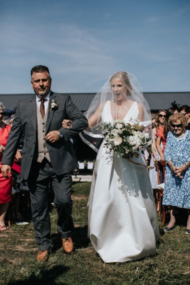 Bride Walking Down the Aisle in a Jesus Peiro Wedding Dress and Veil