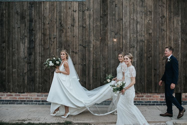 Bride in Jesus Peiro Wedding Dress and Bridesmaids in White Embellished  Frock and Frill Dresses