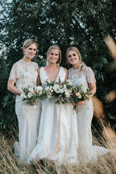 Bridal Party with Bride in Jesus Peiro Wedding Dress and Bridesmaids in White Embellished  Frock and Frill Dresses