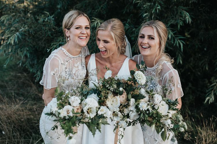Laughing Bridal Party with Bride in Jesus Peiro Wedding Dress and Bridesmaids in White Embellished  Frock and Frill Dresses