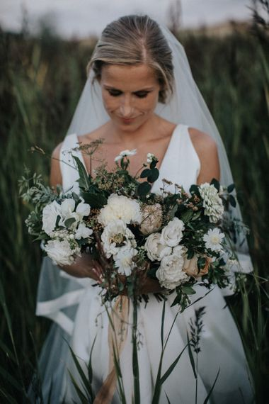 White Flowers and Green Foliage Loosely Tied Wedding Bouquet