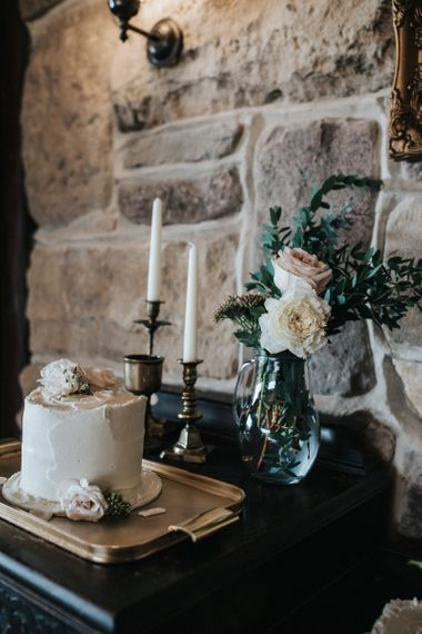 Single Tier Wedding Cake with Gold Candle Sticks and Roses in Vase
