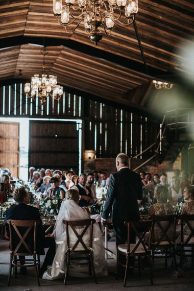 Father of the Bride Speech in Dark Navy Suit  at a Rustic Luxe Barn Wedding Venue