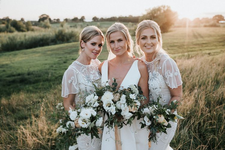 Bridal Party with Bridesmaids in White Embellished Dresses and Bride in Jesus Peiro Wedding Dress