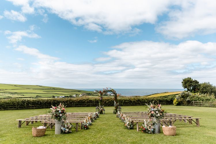Outdoor Wedding Ceremony With Coastal View // The Barn At South Milton Wedding With Outdoor Humanist Ceremony And Floral Arch By Flowers By Passion Images From John Barwood Photography