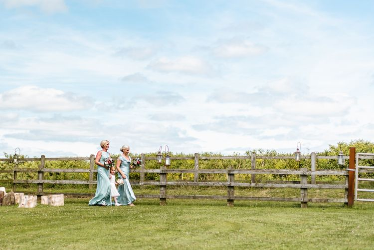 Bridesmaids In Ghost // The Barn At South Milton Wedding With Outdoor Humanist Ceremony And Floral Arch By Flowers By Passion Images From John Barwood Photography
