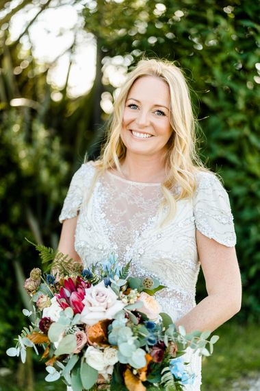 Jenny Packham Bride // The Barn At South Milton Wedding With Outdoor Humanist Ceremony And Floral Arch By Flowers By Passion Images From John Barwood Photography