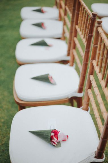 Confetti cones on guests seats at ceremony