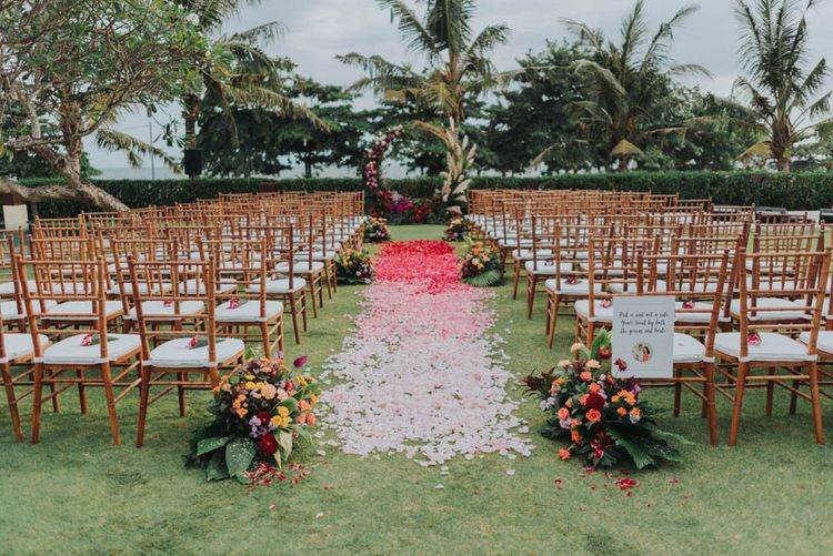 Petals like the aisle for the outdoor ceremony