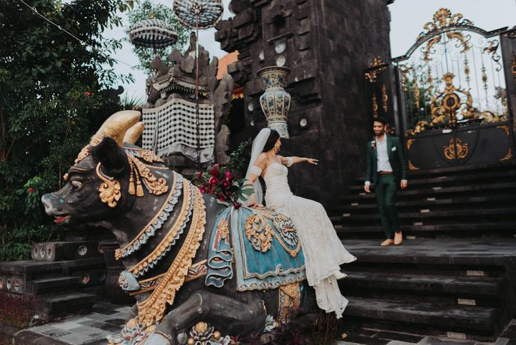 Bride and groom pose in Bali wedding venue grounds