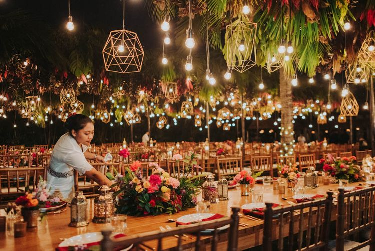 Wedding venue set up with lights and floral installation