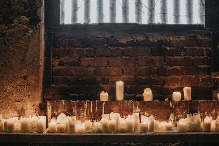 Pillar candles for cosy winter barn ceremony
