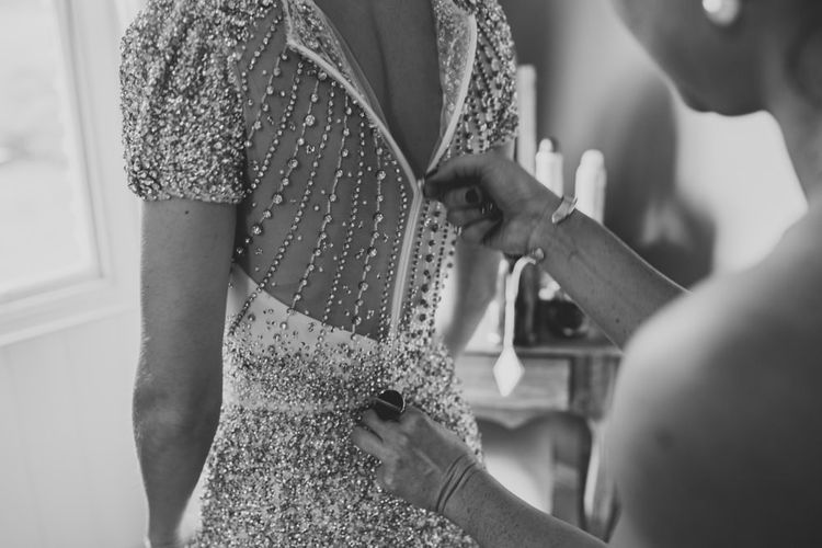Back of brides embellished wedding dress at winter wedding with sparkles and glamour