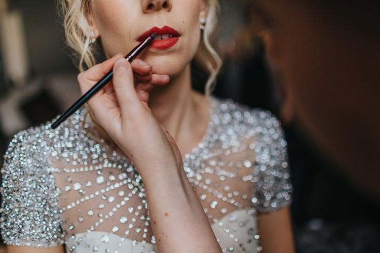 Red lip with brides embellished wedding dress for New Years eve party wedding