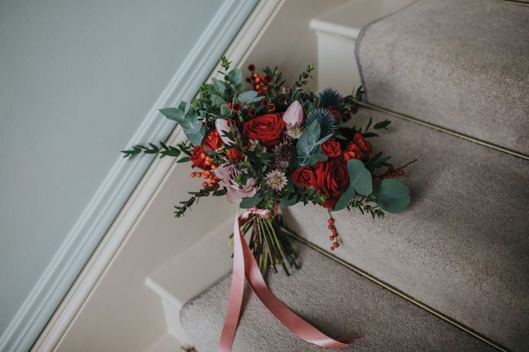Red festive themed floral bouquet for winter wedding