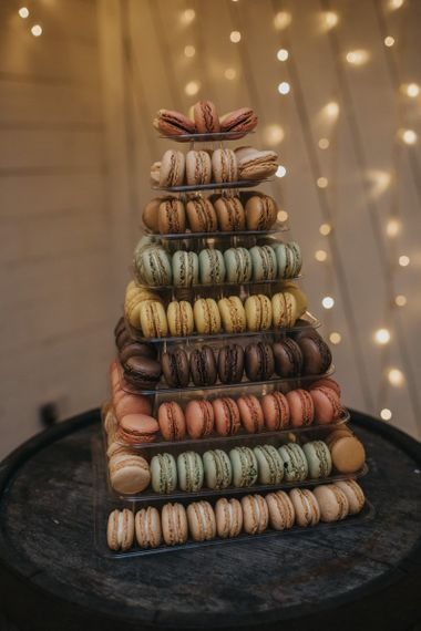 Macaroon tower cake at winter reception for New Years celebration with fairy lights