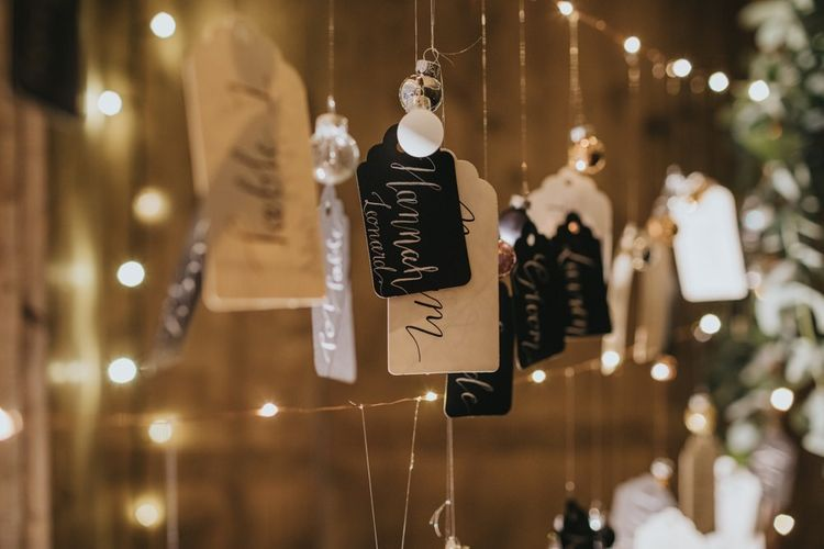 DIY table plan with baubles and fairy lights at winter reception