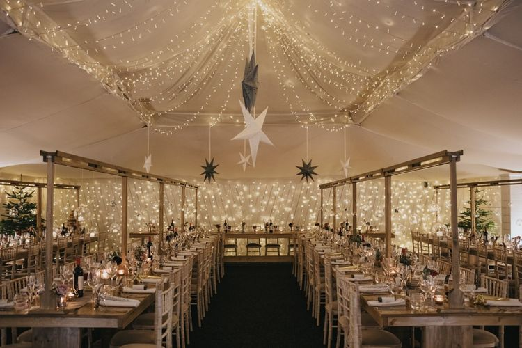 Marquee winter reception styling with star decor and fairy lights for New Years eve celebration