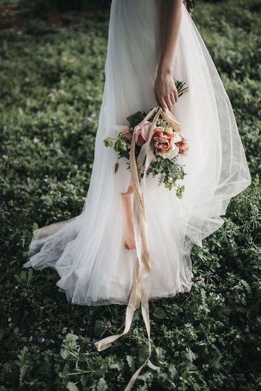 Tulle Susanna Greening Designs  bridal skirt and bouquet tied in silk ribbon