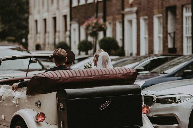 Bride In Pronovias Second-Hand Wedding Dress // Vintage Open Top Wedding Car // Image By Jason Mark Harris