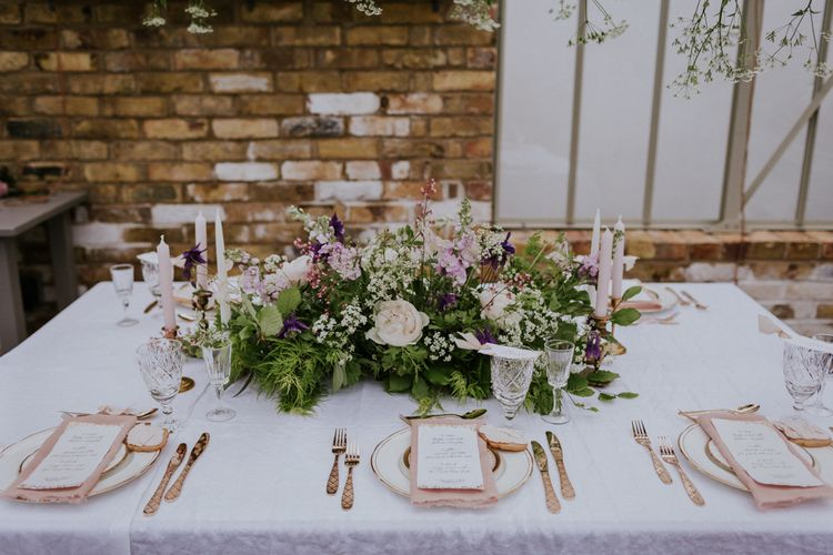 Floral Centrepiece & Elegant Gold Place Setting | Violet Flower Filled Secret English Garden Inspiration in a Glasshouse Styled by The Timeless Stylist | Maja Tsolo Photography
