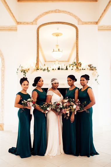 Bridal Party Portrait with Black Bride in Juliet Cap Veil and Eliza Jane Howell Wedding Dress and Bridesmaids in Emerald Green Satin Dresses