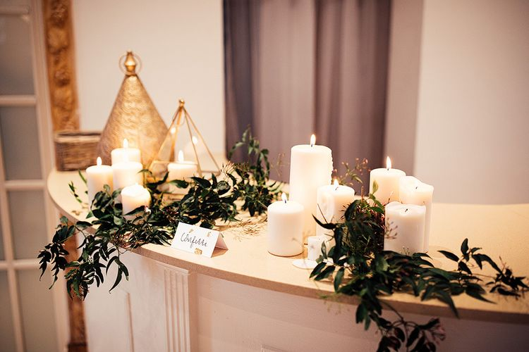 Candles and Foliage Wedding Decor