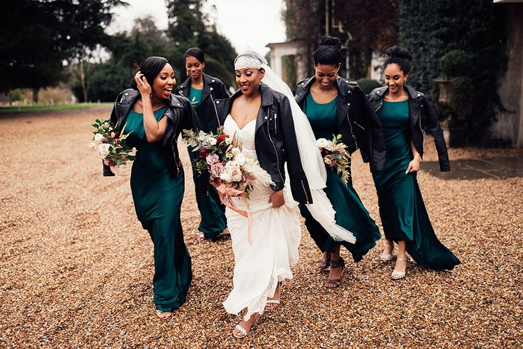 Bridal Party Portrait with Black Bride in Juliet Cap Veil, Eliza Jane Howell Wedding Dress and Leather Jacket and Bridesmaids in Emerald Green Satin Dresses with Leather Jackets