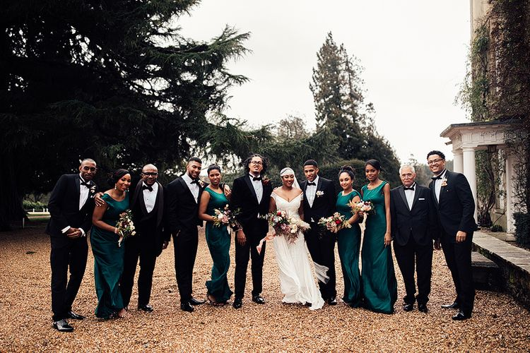 Black Wedding Party Portrait in Tuxedos and Emerald Green Dresses
