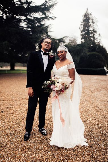 Black Bride in Juliet Cap Veil and Eliza Jane Howell Wedding Dress and Groom in Tuxedo and Bow Tie