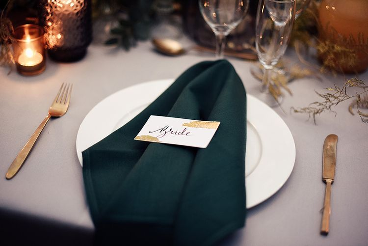 Place Setting with Emerald Green Napkin and White and Gold Name Place Card