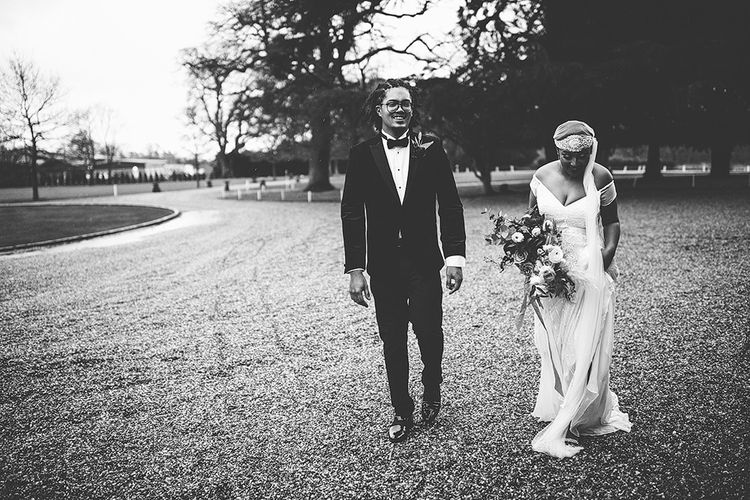 Black and White Portrait of Bride in Juliet Cap Veil and Eliza Jane Howell Wedding Dress and Groom in Tuxedo