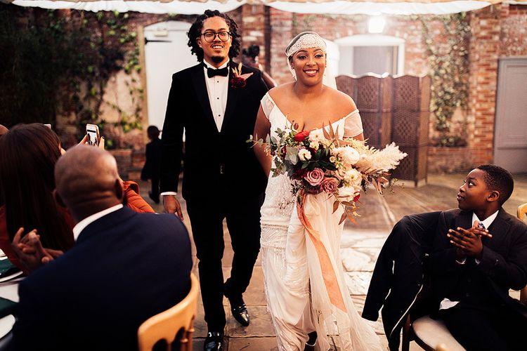 Black Bride in Juliet Cap Veil and Eliza Jane Howell Wedding Dress and Groom in Tuxedo Entering The Wedding Breakfast